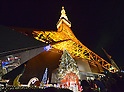 November 3, 2012, Tokyo, Japan - A 15-meter-tall Christmas tree is brightly illuminated with 120,000 LEDs at the foot of Tokyo Tower on Saturday, November 3, 2012, greeting the arrival of the Christmas season.  (Photo by Natsuki Sakai/AFLO)