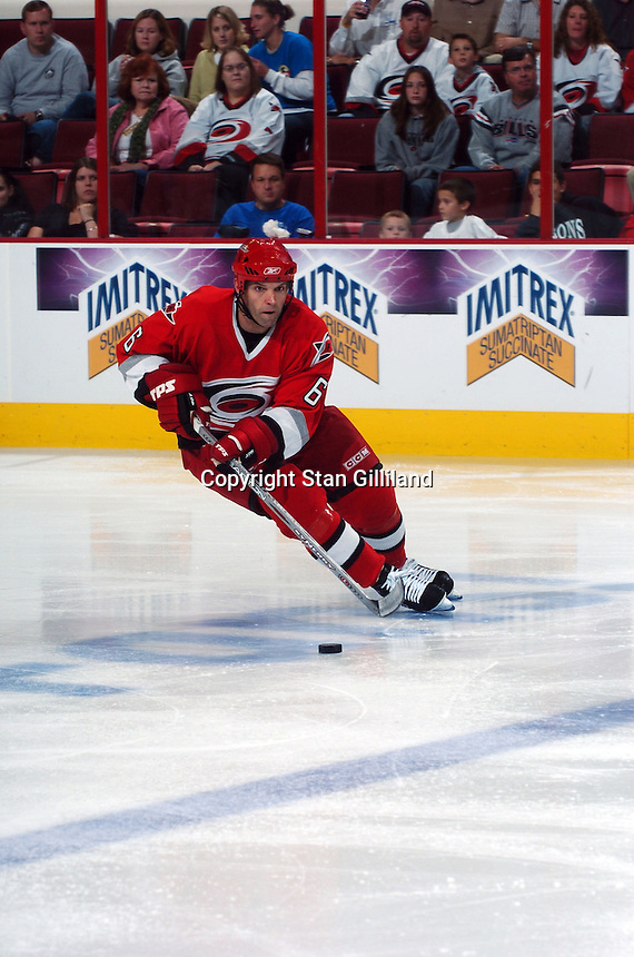 Carolina Hurricanes' Bret Hedican brings the puck up the ice against the Washington Capitals during their game Wednesday, Oct. 12, 2005 in Raleigh, NC. Carolina won 7-2.