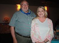 NWA Democrat-Gazette/CARIN SCHOPPMEYER Glenn and Carla Atkins help support the Elizabeth Richardson Center on July 29.