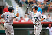 Daytona Tortugas Tyler Stephenson (30) high fives Luis Gonzalez (7) after hitting a home run in the top of the fifth inning during a game against the Florida Fire Frogs on April 7, 2018 at Osceola County Stadium in Kissimmee, Florida.  Daytona defeated Florida 4-3 in a six inning rain shortened game.  (Mike Janes/Four Seam Images)
