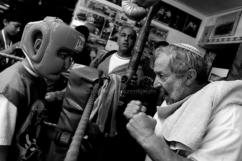 Shajar Barikat receives instructions from his coach and director of the Jerusalem Gershon Luxemburg during a boxing match at the Jerusalem Boxing Club.  Located in a bomb shelter, the club has 150 members in which the big majority is Jewish, with a minority of Arabs from East Jerusalem (15 members).  09/11/2007