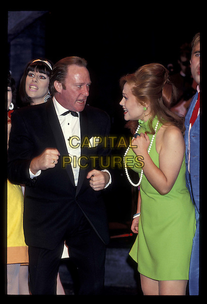 DENNIS WATERMAN & SONIA.Ref:141.green dress, half length, half-length.*RAW SCAN- photo will be adjusted for publication*.www.capitalpictures.com.sales@capitalpictures.com.©Capital Pictures