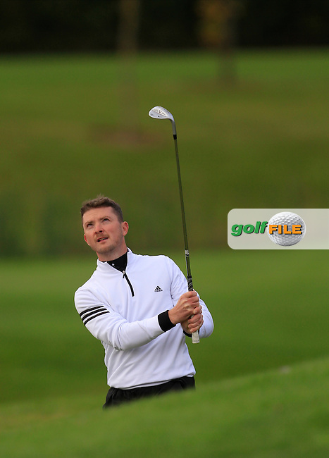 Peter McCarroll (Allen Park Golf Centre) on the 18th during Round 2 of The Cassidy Golf 103rd Irish PGA Championship in Roganstown Golf Club on Friday 11th October 2013.<br /> Picture:  Thos Caffrey / www.golffile.ie