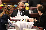 Nevada Assembly Minority Leader Marilyn Kirkpatrick, D-North Las Vegas, Majority Leader Paul Anderson, R-Las Vegas, and Chief Clerk Susan Furlong talk on the Assembly floor at the Legislative Building in Carson City, Nev., on Friday, May 22, 2015. <br /> Photo by Cathleen Allison