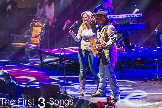 "Trisha Yearwood and Garth Brooks perform at the George Jones Tribute Concert ""Playin' Possum: The Final No Show"" at Bridgestone Arena in Nashville, TN"