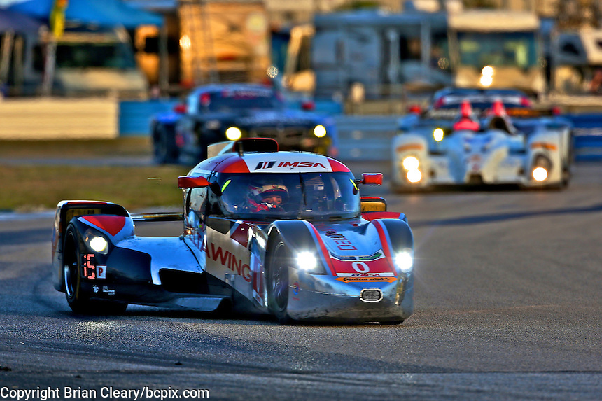 The #0 DeltaWing race car of Andy Meyrick, Katherine Legge and Gabby Chaves leads a pack of cars during the 12 Hours of Sebring, Sebring International Raceway, Sebring, FL, March 2014.  (Photo by Brian Cleary/www.bcpix.com)