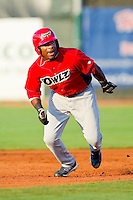 Chevy Clarke (18) of the Orem Owlz takes off for third base against the Ogden Raptors at Lindquist Field on July 28, 2012 in Ogden, Utah.  The Raptors defeated the Owlz 8-7.   (Brian Westerholt/Four Seam Images)