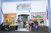 Store owners and visitors outside Mele Ukulele store in Wailuku, Maui