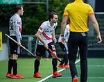 AMSTELVEEN -   Tijn Lissone (Adam)  en  Tom Hiebendaal (Adam) komen inzet veld tijdens de hoofdklasse competitiewedstrijd heren, AMSTERDAM-ROTTERDAM (2-2). COPYRIGHT KOEN SUYK