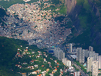 The Rocinha Slum clings to a hillside near the posh high rises of the fashionable Sao Conrado district of Rio de Janeiro.(AustralFoto/Douglas Engle)