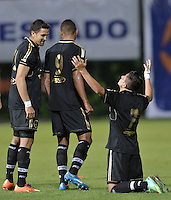 BOGOTÁ -COLOMBIA-20-04-2014. Diego Gomez (Der) de Fortaleza FC celebra un gol en contra de Deportivo Pasto durante partido por la fecha 18 de la Liga Postobón I 2014 jugado en el estadio Metropolitano de Techo en Bogotá./ Diego Gomez (R) of Fortaleza FC celebrates a goal against Deportivo Pasto during the match for the 18th date of Postobon League I 2014 played at Metropolitano de Techo stadium in Bogota. Photo: VizzorImage / Gabriel Aponte / Staff