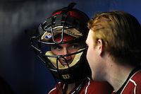 Batavia Muckdogs outfielder Connor Burke (16) in the dugout wearing a catchers mask talking with Chad Wallach during a game against the Williamsport Crosscutters on August 16, 2013 at Dwyer Stadium in Batavia, New York.  Batavia defeated Williamsport 5-2.  (Mike Janes/Four Seam Images)