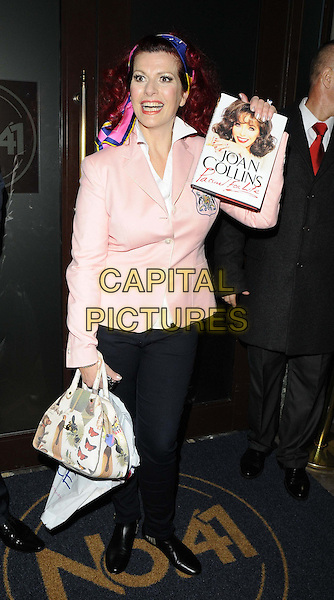 Cleo Rocos<br /> attended the &quot;Joan Collins: Passion for Life&quot; book launch party, The Westbury Hotel, London, England.<br /> October 21st, 2013<br /> full length pink blazer scarf in hair handbag purse print mouth open<br /> CAP/CAN<br /> &copy;Can Nguyen/Capital Pictures