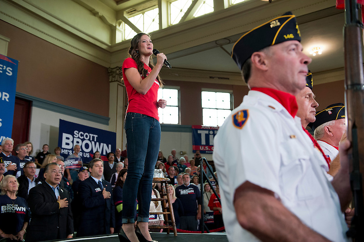 UNITED STATES - OCTOBER 20:  Ayla Brown, daughter of Sen. Scott Brown, R-Mass., performs the National Anthem before a rally with her father and Sen. John McCain, R-Ariz., at Memorial Hall in Melrose, Mass.  Brown is being challenged for his seat by democrat Elizabeth Warren.  (Photo By Tom Williams/CQ Roll Call)