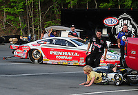 Jun. 15, 2012; Bristol, TN, USA: NHRA a youngster lays his scooter down and crew members from pro stock driver Mike Edwards and Allen Johnson race to his rescue during qualifying for the Thunder Valley Nationals at Bristol Dragway. Mandatory Credit: Mark J. Rebilas-