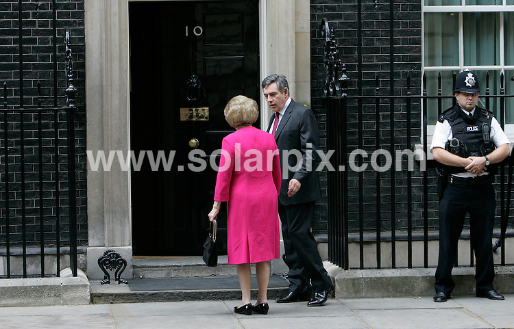 **ALL ROUND PICTURES FROM SOLARPIX.COM**.**NO UK NEWSPAPER PUBLICATION **UK MAGAZINE PUBLICATION ONLY** AND NO PUBLICATION IN FRANCE, SCANDINAVIA, AUSTRALIA AND GERMANY** .Former British Prime Minster Margaret Thatcher is pictured with the current PM Gordon Brown on the steps of Downing Street yesterday..JOB REF:4657- SFE       DATE:14-09_07 .**MUST CREDIT SOLARPIX.COM OR DOUBLE FEE WILL BE CHARGED* *UNDER NO CIRCUMSTANCES IS THIS IMAGE TO BE REPRODUCED FOR ANY ONLINE EDITION WITHOUT PRIOR PERMISSION*