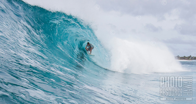 Surfer getting a tube ride at Rocky Rights on the North Shore of Oahu