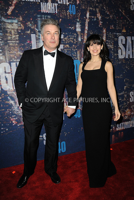 WWW.ACEPIXS.COM<br /> February 15, 2015 New York City<br /> <br /> Alec Baldwin and Hilaria Thomas walking the red carpet at the SNL 40th Anniversary Special at 30 Rockefeller Plaza on February 15, 2015 in New York City.<br /> <br /> Please byline: Kristin Callahan/AcePictures<br /> <br /> ACEPIXS.COM<br /> <br /> Tel: (646) 769 0430<br /> e-mail: info@acepixs.com<br /> web: http://www.acepixs.com