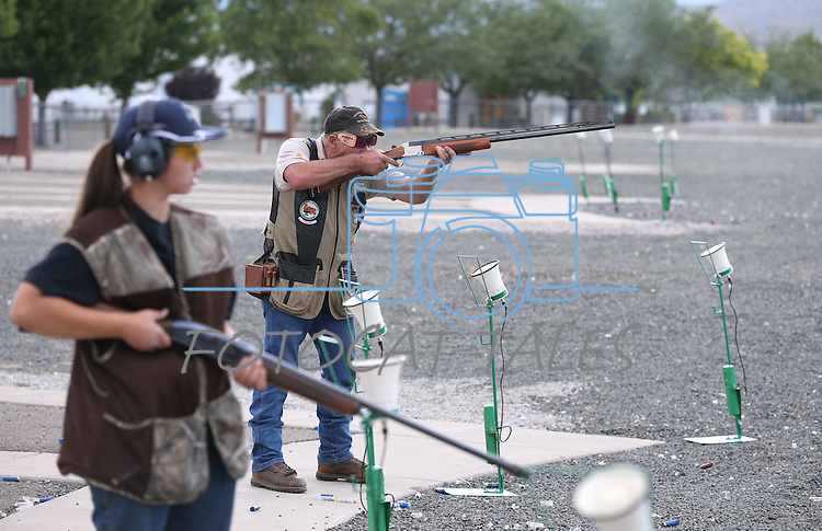 Coach Greg and Kristin McKown, 19, practice at the Capital City Gun Club, in Carson City, Nev., on Friday, July 11, 2014.<br /> Photo by Cathleen Allison