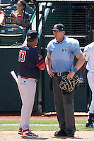 Peoria Chiefs manager Joe Kruzel (13) argues a call with umpire Andy Stukel during the first game of a doubleheader against the South Bend Cubs on July 25, 2016 at Four Winds Field in South Bend, Indiana.  South Bend defeated Peoria 9-8.  (Mike Janes/Four Seam Images)