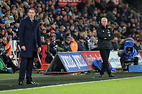 (L-R) Swansea manager Paul Clement and West Bromwich Albion manager Alan Pardew  watch the game from the touch line during the Premier League match between Swansea City and West Bromwich Albion at The Liberty Stadium, Swansea, Wales, UK. Saturday 09 December 2017