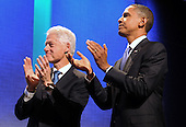 Former United States President Bill Clinton, left, and US President Barack Obama, right, welcome US First Lady Michelle Obama (not pictured) at the Clinton Global Initiative (CGI) in New York, New York, USA, Thursday, 23 September 2010. President Obama joined sixty-four current and former heads of state in attending the sixth annual meeting of the CGI.  The commitment of CGI members has improved the lives of more than 220 million people in 170 countries, according to President Bill Clinton.  The 2010 meeting features a session on 'Peace and Beyond in the Middle East'.  .Credit: Michael Reynolds - Pool via CNP