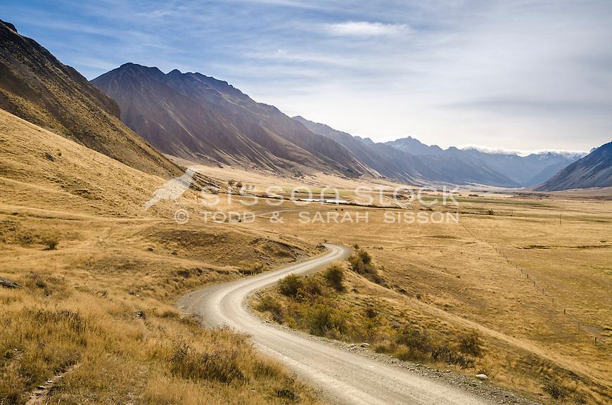Winding gravel road through farmland in the Ahuriri Valley, summer, Canterbury, South Island, New Zealand- stock photo, canvas, fine art print