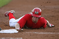 September 3, 2009:  Left Fielder Kyle Conley of the Batavia Muckdogs dives back to first during a game at Dwyer Stadium in Batavia, NY.  The Muckdogs are the Short-Season Class-A affiliate of the St. Louis Cardinals.  Photo By Mike Janes/Four Seam Images