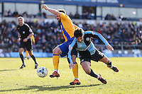 Joe Jacobson of Wycombe Wanderers (right) and Chris Clements of Mansfield Town (left) battle for the ball during the Sky Bet League 2 match between Wycombe Wanderers and Mansfield Town at Adams Park, High Wycombe, England on 25 March 2016. Photo by David Horn.