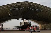 The space shuttle Enterprise, mounted on transport vehicle, is backed into a temporary hanger after being demated from the NASA 747 Shuttle Carrier Aircraft (SCA) at John F. Kennedy (JFK) International Airport in Jamica, New York, Sunday, May 13, 2012. Enterprise will be placed on a barge that will move by tugboat up the Hudson River to the Intrepid Sea, Air & Space Museum in June. The shuttle will be lifted by crane and placed on the flight deck of the Intrepid, where it will be on exhibit to the public starting this summer in a temporary climate-controlled pavilion..Mandatory Credit: Kim Shiflet / NASA via CNP
