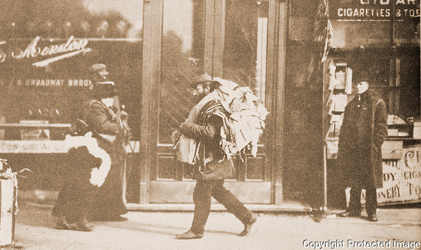 """Historical Photos:  """"Carrying Work Home, c. 1910"""".  Lewis Hine, photographer. PORTAL TO AMERICA, Schoener, p. 178.  Photo 1977."""