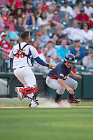 Matt Thaiss (19) of the US Collegiate National Team is tagged out by Cuban National Team catcher Frank Camilo Morejon Reyes (45) at BB&T BallPark on July 4, 2015 in Charlotte, North Carolina.  The United State Collegiate National Team defeated the Cuban National Team 11-1.  (Brian Westerholt/Four Seam Images)