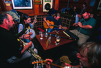 Irish musicians performing at Gus O'Connor's Pub, Doolin, County Clare, Ireland