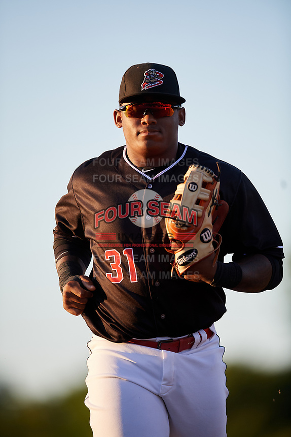 Batavia Muckdogs right fielder Albert Guaimaro (31) jogs to the dugout during a game against the State College Spikes on July 7, 2018 at Dwyer Stadium in Batavia, New York.  State College defeated Batavia 7-4.  (Mike Janes/Four Seam Images)