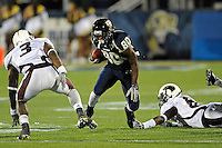 6 November 2010:  FIU wide receiver Jason Frierson (80) attempts to evade Louisiana-Monroe safety Alex Ibe (3) after breaking a tackle in the fourth quarter as the FIU Golden Panthers defeated the University of Louisiana-Monroe Warhawks, 42-35 in double overtime, at FIU Stadium in Miami, Florida.