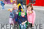 Sarah Cavanagh, Callum O'Sullivan and Johanna McMahon enjoying their hotdog at the Food Festival in Tralee on Sunday