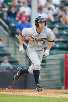 Dustin Fowler (18) of the Charleston RiverDogs hustles down the first base line against the Hickory Crawdads at L.P. Frans Stadium on May 25, 2014 in Hickory, North Carolina.  The RiverDogs defeated the Crawdads 17-10.  (Brian Westerholt/Four Seam Images)