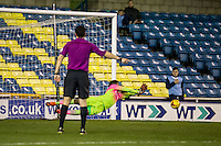 Goalkeeper Jamal Blackman (on loan from Chelsea) of Wycombe Wanderers saves the penalty during the Checkatrade Trophy round two Southern Section match between Millwall and Wycombe Wanderers at The Den, London, England on the 7th December 2016. Photo by Liam McAvoy.