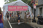 Children play under sprinklers in the Polish bath house at the annual gathering of Slavic cuisine lovers at Pierogi Fest on 119th Street in Whiting, Indiana on July 26, 2009.