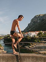 "One of the Stari Most diver, usually called ""The Icarus of Mostar"", prepares himself before jumping into the Neretva River 23 meters below. This old tradition has become a tourist attraction at the Bosnian city of Mostar."