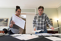 Admission staff stuff envelopes that will be sent to accepted applicants of Occidental College, March 22, 2017.<br /> (Photo by Marc Campos, Occidental College Photographer)