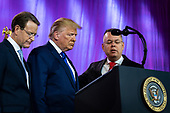 United States President Donald J. Trump prays with Tony Perkins, President, Family Research Council (left) and Pastor Andrew Brunson, Honoree, Values Voter Summit before delivering remarks at Values Voter Summit at the Omni Shoreham Hotel on October 12, 2019 in Washington, DC. The appearance at the Summit comes as evangelical leaders this week criticized Trump's decision to stand down US forces in northern Syria.  <br /> Credit: Pete Marovich / Pool via CNP