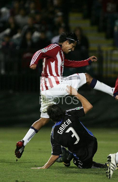 Nick Garcia (3) slide tackles Paulo Nagamura. Chivas USA defeated San Jose Earthquakes 1-0 at Buck Shaw Stadium in Santa Clara, California on May 2, 2009.