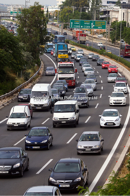 Pictured: Traffic on the motorway on the outskirts of Athens, Greece STOCK PICTURE<br /> Re: Diesel cars and trucks will be banned in Paris, Madrid, Athens and Mexico City by 2025 as part of a groundbreaking initiative to curb pollution.<br /> At a climate meeting in Mexico, the cities' mayors also pledged to incentivise electric, hybrid and hydrogen vehicles, and walking and cycling.<br /> The move comes amid increasing concerns about the impact of diesel engines on the health of people living in cities. <br /> Last week a report found that air pollution causes nearly half a million premature deaths each year in Europe alone.