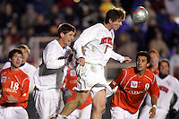 New Mexico's Jeff Rowland (6) heads the ball clear in his own penalty area. The University of New Mexico defeated Clemson University 2-1 in the NCAA Semifinal at SAS Stadium in Cary, North Carolina, Friday, December 9, 2005.