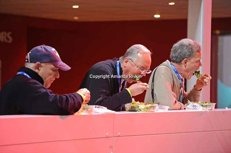 Members of the media enjoy salads at lunchtime at the Detroit Auto Show in Detroit, Michigan on January 11, 2009.