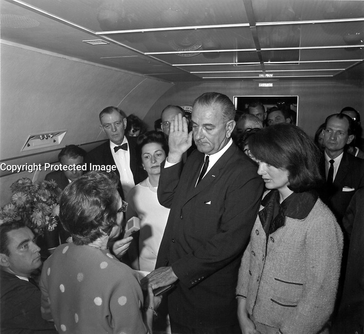 Lyndon Johnson taking the oath of office on Air Force Once following the assassination of John Kennedy, Dallas, Texas, November 22, 1963.<br /> <br /> Credit: Lyndon Baines Johnson Library.