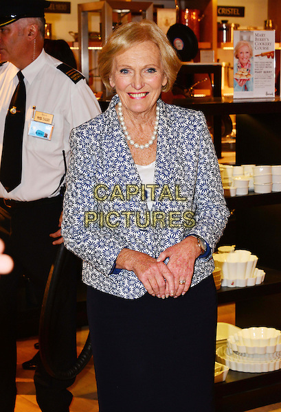 Mary Berry<br /> Celebrity chef and star of The Great British Bake Off meets with fans and sign copies of her book 'Mary Berry's Cookery Course' at Harrods, Knightsbridge, London, UK, 31st May 2013.<br /> half length blue white print jacket pearl necklace beads flower floral patterned <br /> CAP/BF<br /> &copy;Bob Fidgeon/Capital Pictures