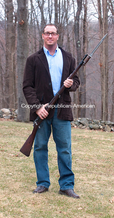 MIDDLEBURY CT- APRIL 08 2015 040815DA03- Peter J. Hopson of Middlebury holds a bayonette and rifle from 1898. Hopson'S great-great grandfathers met when one rescued the other from a Confederate prison camp.<br /> Darlene Douty Republican American