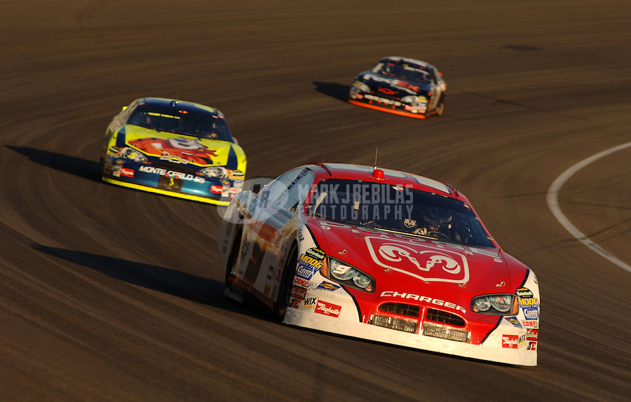 Sept. 3, 2006; Fontana, CA, USA; Nascar Nextel Cup driver Kasey Kahne (9) leads Kyle Busch (5) and Denny Hamlin (11) during the Sony HD 500 at California Speedway. Mandatory Credit: Mark J. Rebilas